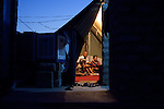 DOMIZ, IRAQ: Abu Rafed and his family sit in their tent in the Domiz refugee camp...Over 7,000 Syrian Kurds have fled the violence in Syria and are living in the Domiz refugee camp in the semi-autonomous region of Iraqi Kurdistan...Photo by Ali Arkady/Metrography