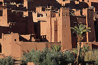 Houses at Ksar Ait Ben Haddou, earthen fortified city, Ounila valley, Ouarzazate province, Morocco. The ksar is a group of earthen houses surrounded by high defensive walls with corner towers, in traditional pre-Saharan style.  The village stands above the Oued Marghen river in the High Atlas and was a stop on the caravan route from the Sahara to Marrakech. It was founded in the 17th century and has been a UNESCO World Heritage Site since 1987. Picture by Manuel Cohen