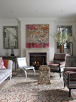 The living room is furnished in Kit Kemp's hallmark style using a combination of fabric and texture