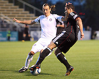 Charlie Davis#9 of D.C. United control;s the ball in front of Bratislav Ristic#77 of the Chicago Fire during a second round match of the Carolina Challenge on March 9 2011 at Blackbaud Stadium, in Charleston, South Carolina. D.C. United won 1-0.