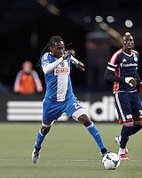 Philadelphia Union midfielder Keon Daniel (26) brings the ball forward. In a Major League Soccer (MLS) match, the New England Revolution (blue/red) defeated Philadelphia Union (blue/white), 2-0, at Gillette Stadium on April 27, 2013.