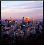 The view at sunset of downtown Montreal from the Mount Royal park, which includes the highest spot in the city.