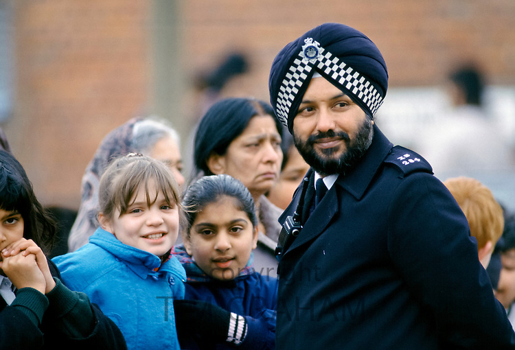 Sikh policeman of Metropolitan Police Force at work in the East End of London, England, UK