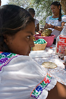 """A big meal of """"Mixiote"""" is prepared and enjoyed with the Quiterio family. Mixiote is prepared by burying the chickent and spices over hoy coals and rocks the covering everything up with layers of Maguey leaves and earth. Cardonal Valley, Hidalgo, Mexico. Friday, May 2, 2008"""