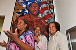 "Three woman members of Citified Book Club, posing for portrait in front of ""Made in America"" painting, at African American Museum of Nassau County during Family Portrait Day, an event by Long Island Center of Photography, in Hempstead, New York, on September 17, 2011."