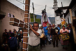 Residents in a Semana Santa procession in the highlands of Uspantan, Guatemala, on March 30, 2012. This area suffered heavy violence against the residents during the civil war, where the military publicly executed possible guerrillas in the plaza.