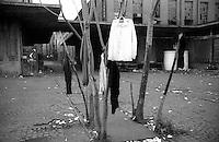 Roma  31 Gennaio  1991.Ex Pastificio Pantanella occupato da centinaia di immigrati asiatici provenienti dal Pakistan e Bangladesh..Un mondo scomparsoi..Rome 31 January  1991.Ex Pastificio Pantanella occupied by hundreds of Asian immigrants from Pakistan and Bangladesh..A lost world