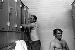 Changing rooms each man has his own locker. South Kirkby Colliery, Yorkshire England. 1979. Coal Miners story  ?Opened in 1881, closed in 1988 and later damaged. Photographs show Dave Bennett ( Official )and Ernie Moore (Face Man)