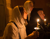 JERUSALEM - AUGUST 25 : Unidentified nuns take part in a candle procession as part of the feast of the Assumption of the Virgin Mary on August 25 2012 in old Jerusalem Israel
