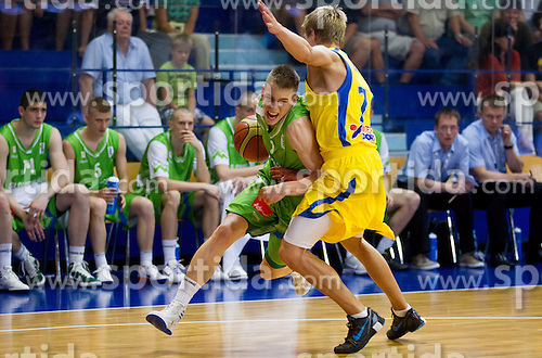 Klemen Prepelic of Slovenia vs Tobias Borg of Sweden during basketball match between National teams of Sweden and Slovenia in First Round of U20 Men European Championship Slovenia 2012, on July 13, 2012 in Domzale, Slovenia. (Photo by Vid Ponikvar / Sportida.com)