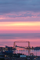 &quot;Illuminations at Sunrise&quot;<br /> The rising sun paints Lake Superior and the sky in hues of pink as rain clouds move in to close the curtains on the spectacular show. The Aerial Lift Bridge is Duluth's gateway to the Great Lake.