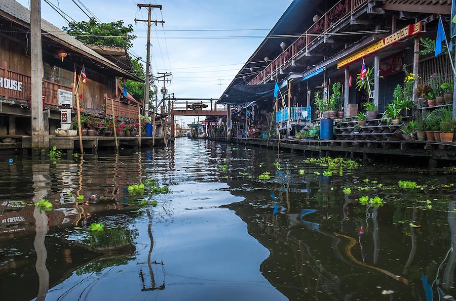 DAMNOEN SADUAK, THAILAND - CIRCA SEPTEMBER 2014: Canals around the Damnoen Saduak floating market in the central region of Thailand.