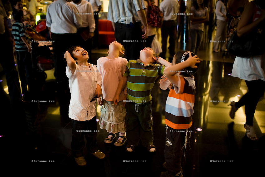 Children look up at reflections in the mirrored ceiling during the Chanuka celebrations organised by Chabad Bangkok on 13th December 2009, at Paragon Mall's IMAX theater, Bangkok, Thailand..Photo by Suzanne Lee / For Chabad Lubavitch