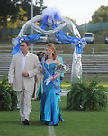 Megan Westmoreland is escorted by Randy Peacock during Homecoming ceremonies before the Water Valley vs. J.Z. George football game in Water Valley, Miss. on Friday, September 10, 2010.