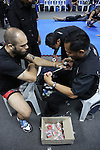 Florian Garel, Zendokai Karate Champion prepares in blue locker room<br />