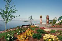 White Rock, BC, British Columbia, Canada - Seaside Promenade Walkway and Coast Salish and Haida Totem Poles in Lions Park along Semiahmoo Bay, Autumn / Fall (Model Released)