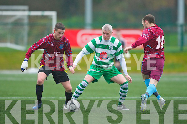 David Hayes Killarney Celtic keeps the Rockmount forward Ray Lynch at bay during their cup clash in Killarney on Sunday