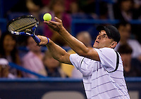 American Andy Roddick lightly tosses the ball as he moves into his service motion during the Legg Mason Tennis Classic at the William H.G. FitzGerald Tennis Center in Washington, DC.  Giles Simon defeated Andy Roddick in straight sets in a thunderstorm delayed evening session.