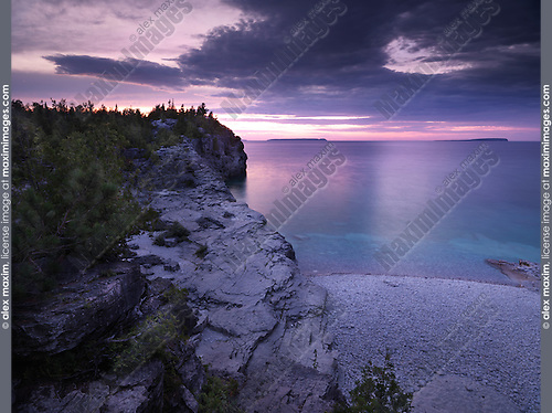 Beautiful sunset scenery of Georgian Bay rocky shore. Bruce Peninsula National Park, Ontario, Canada.