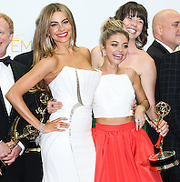 LOS ANGELES, CA, USA - AUGUST 25: Actresses Sofia Vergara and Sarah Hyland, winners of the Outstanding Comedy Series Award for 'Modern Family' pose in the press room at the 66th Annual Primetime Emmy Awards held at Nokia Theatre L.A. Live on August 25, 2014 in Los Angeles, California, United States. (Photo by Celebrity Monitor)