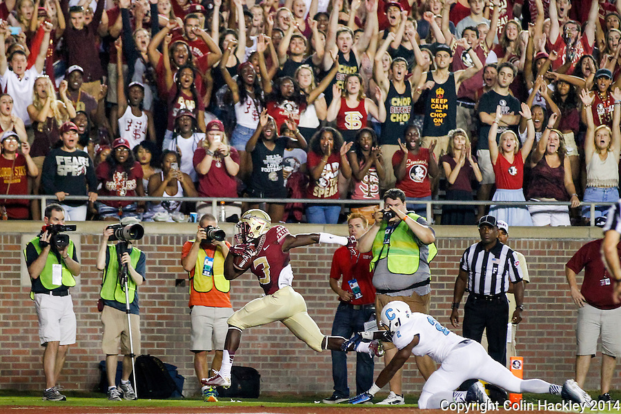 TALLAHASSEE, FL 9/6/14-FSU-CITADEL-Florida State's Jesus Wilson scores Florida State's second touchdown against the Citadel's Cody Richardson during first half action Sept. 6, 2014 at Doak Campbell Stadium in Tallahassee. <br /> <br /> COLIN HACKLEY PHOTO