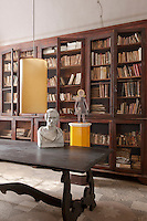 On the library table the antique bust is an ancestor, Gaetano Oltrona Visconti, and the lacquered wire figurine is another sculpture by Benedetta Mori Ubaldini