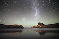 Just after 3am, the Milky Way shines brightly above The Gap at Castlepoint, as the nearby lighthouse illuminates the surrounding landscape. Castlepoint is on the south east coast of the North Island of New Zealand just a few hours from from the capital city of Wellington.