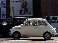 Roma 30 Aprile 2010.Un veccho modello della  Fiat 500  tra il traffico di Roma