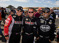 Jul. 27, 2014; Sonoma, CA, USA; NHRA top fuel driver Billy Torrence and his son, Steve Torrence (center) stand with Khalid Albalooshi during the Sonoma Nationals at Sonoma Raceway. Mandatory Credit: Mark J. Rebilas-