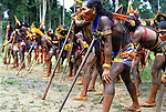 Altamira, Brazil. Group of Kayapo Indians leaning on 'bordunas' at protest again proposed dams.