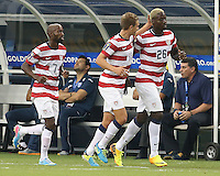 Eddie Johnson #26 of the USMNT celebrates scoring a goal with his team mates in the first half of the match against Honduras on July 24, 2013 the match at Dallas Cowboys Stadium in Arlington, TX. USMNT won 3-1.