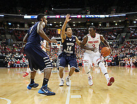 Ohio State's Shannon Scott (3) is guarded by North Florida's Dallas Moore (14) during the first half Friday, Nov. 29, 2013, in Columbus, Ohio. (Photo by Terry Gilliam)