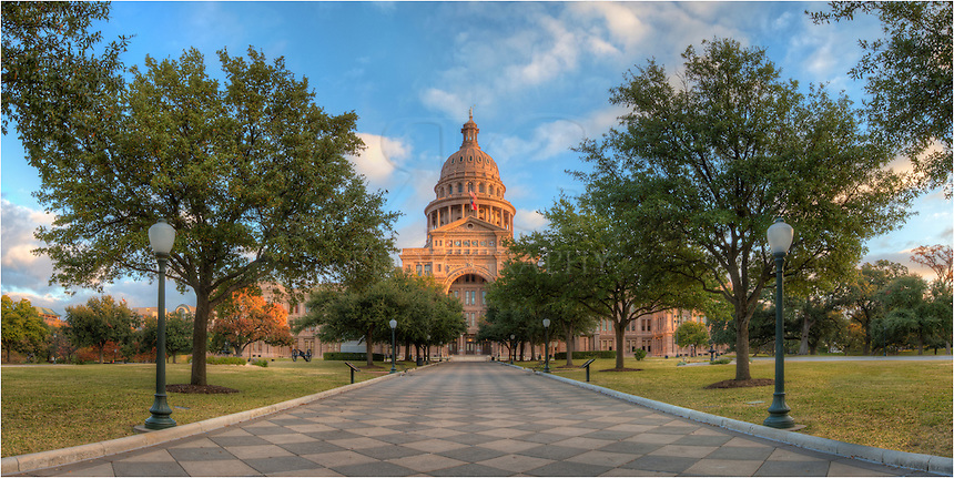 From just a little after sunrise, this panorama shows the grounds of the Texas state capitol. The building of the state government sits on over 20+ acres of beautifully kept grass, trees, monuments, and other landscaping. On mornings such as this - a non-work day for govt. employees - you'll often have the entire area all to yourself except for an occasional biker or jogger.