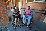 Hope Ranganayi (left) suffered a spinal injury in an automobile accident, and today uses a wheelchair to get around the National Rehabilitation Centre in Ruwa, Zimbabwe, where she studies purchasing and supply management. Ranganayi's wheelchair, which was carefully fitted to her individual needs, was provided by the Jairos Jiri Association with support from CBM-US.