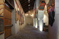 Low angle view of nave showing wall paintings of bestiary (20th century copies),  Lombard Romanesque style Church of Sant Joan de Boi, 11th century, Catalonia, Spain. On the undersides of arches and in the lower part of the church are murals representing the Medieval bestiary, a mix of known animals and fantastic beasts. The murals are now preserved at the National Museum of Catalan Art (MNAC) in Barcelona. Picture by Manuel Cohen.