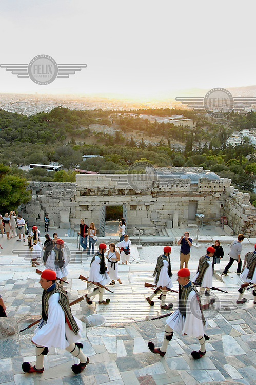 Soldiers of the Presidential Guard march to the Acropolis for the flag lowering ceremony. This takes place each week on a Sunday and is accompanied by the National Anthem.