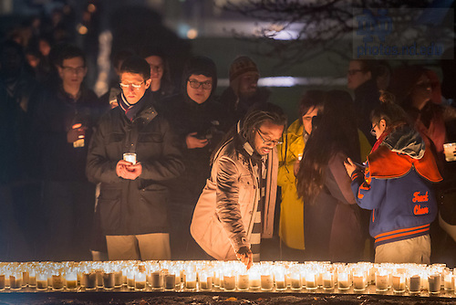 "January 16, 2017; Participants form a candlelight procession following a prayer service in the Main Building in observation of Martin Luther King Jr. Day. The event also marked the beginning of ""Walk the Walk"" week, a series of events an observances to celebrate and reflect on diversity and inclusiveness. (Photo by Matt Cashore/University of Notre Dame)"