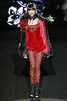 Zen walks runway in a You Are So Beautiful outfit, from the Betsey Johnson Fall 2011 He Loves Me Not - Black Tag collection, during Mercedes-Benz Fashion Week Fall 2011.