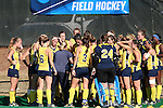 15 November 2015: Michigan head coach Marcia Pankratz (in gray) talks to her players before the game. The University of North Carolina Tar Heels played the University of Michigan Wolverines at Francis E. Henry Stadium in Chapel Hill, North Carolina in a 2015 NCAA Division I Field Hockey Tournament Quarterfinal match. UNC won the game 1-0.
