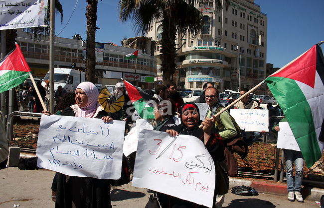 Palestinians participate in a march calling for a reconciliation between the rival Palestinian leading factions Hamas in Gaza and Fatah in the West Bank, in Ramallah, Monday, March 14, 2011. Photo by Issam Rimawi
