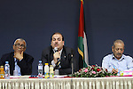 Yasser al-Wadia, a member of the Palestine Liberation Organization, speaks during a meeting of chamber of commerce and industry, in Gaza city on Sep. 30, 2014. Photo by Mohammed Asad