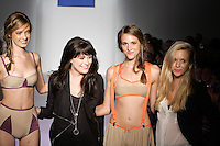 Fashion designers Daisy Hartmann, and Elizabeth NeSmith walk the runway with models at the close of their Daisy & Elizabeth Spring 2012 show, at Nolcha Fashion Week Spring 2012.