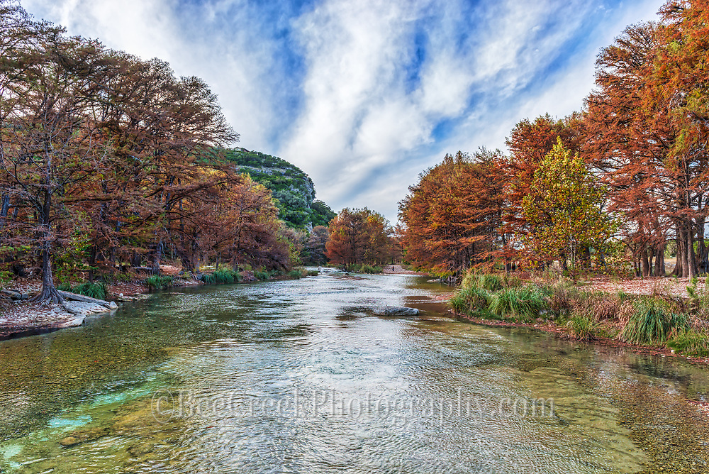 We came back here again as we found this a beautiful section along the Frio River in Con Can.  So we capture this today with the wonders fall colors and the blue green waters as they ripple past us on their way down stream with a clouds in the sky.