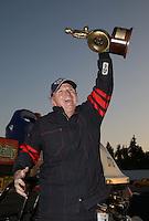 Feb. 17, 2013; Pomona, CA, USA; NHRA super comp driver Phil Dion celebrates after winning the Winternationals at Auto Club Raceway at Pomona. Mandatory Credit: Mark J. Rebilas-