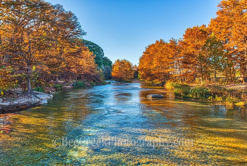 This was such a pretty place with the Frio flowing  with its cool clears waters on a beautiful fall day.  The cypress that grow along the river were beautiful with their fall colors of oranges, yellows and reds as they contrast against the flowing  blue waters. As the sun was getting lower it cast these golden colors as the light filtered through the trees.