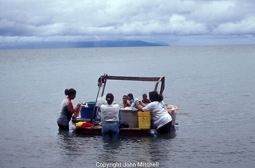 Women washing clothing in Lake Nicaragua, Isla de Ometepe, Nicaragua