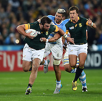 Frans Malherbe of South Africa takes on the Argentina defence. Rugby World Cup Bronze Final between South Africa and Argentina on October 30, 2015 at The Stadium, Queen Elizabeth Olympic Park in London, England. Photo by: Patrick Khachfe / Onside Images