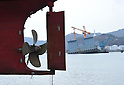 April 1st, 2011, Kamaishi, Japan - A floating dock in the background and an ocean going vessel are left aground in the port of Kamaishi , Iwate Prefecture, on April 1, 2011, three weeks after this major northeastern Japanese port was destroyed by a magnitude 9.0 earthquake and ensuing tsunami. (Photo by Natsuki Sakai/AFLO) [3615] -mis-...