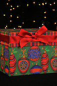 Christmas gift box with holiday lights for greeting cards