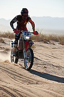 5x Honda motorcyle of Francisco Arredondo passes race mile 58 in 2012 San Felipe Baja 250, San Felipe, Baja California, Mexico.